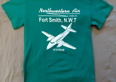 green t-shirt with airplane logo